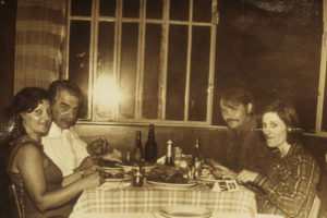 Josef Mengele (left rear) dining with his wife and guests in Brazil, circa 1960. Wikipedia