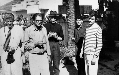 From left to right, Paul Bowles, Allen Ginsberg, William Burroughs, and others, early 1950s